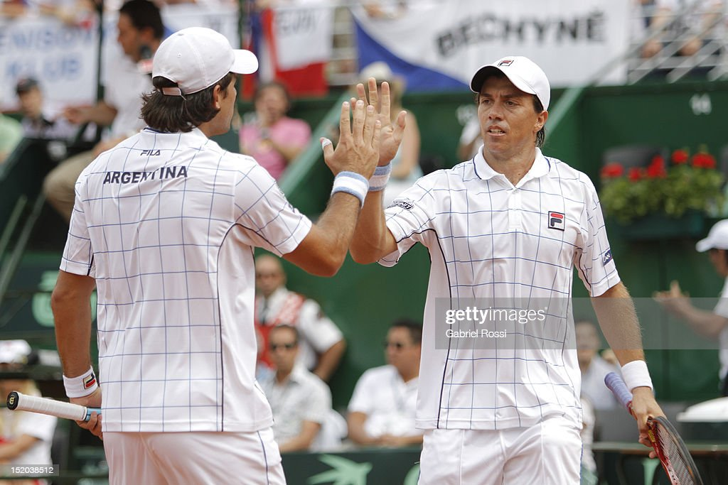 <a gi-track='captionPersonalityLinkClicked' href=/galleries/search?phrase=Carlos+Berlocq&family=editorial&specificpeople=553854 ng-click='$event.stopPropagation()'>Carlos Berlocq</a> and Eduardo Shuank of Argentina celebrate a point during the match between Argentina and Czech Republic as part of the second day of the Davis Cup Semi-final at Mary Tern de Weiss Stadium on September 15, 2012 in Buenos Aires, Argentina.