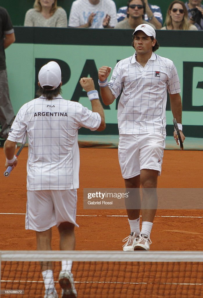 Carlos Berlocq and Eduardo Shuank of Argentina celebrate a point during the match between Argentina and Czech Republic as part of the second day of the Davis Cup Semi-final at Mary Tern de Weiss Stadium on September 15, 2012 in Buenos Aires, Argentina.