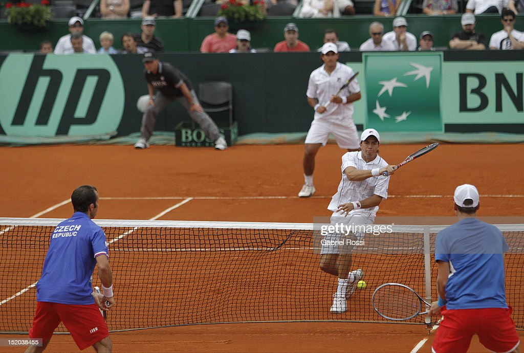 <a gi-track='captionPersonalityLinkClicked' href=/galleries/search?phrase=Carlos+Berlocq&family=editorial&specificpeople=553854 ng-click='$event.stopPropagation()'>Carlos Berlocq</a> and Eduardo Shuank of Argentina plays against <a gi-track='captionPersonalityLinkClicked' href=/galleries/search?phrase=Tomas+Berdych&family=editorial&specificpeople=239147 ng-click='$event.stopPropagation()'>Tomas Berdych</a> and <a gi-track='captionPersonalityLinkClicked' href=/galleries/search?phrase=Radek+Stepanek&family=editorial&specificpeople=193842 ng-click='$event.stopPropagation()'>Radek Stepanek</a>of Czech Republic during the match between Argentina and Czech Republic as part of the second day of the Davis Cup Semi-final at Mary Tern de Weiss Stadium on September 15, 2012 in Buenos Aires, Argentina.
