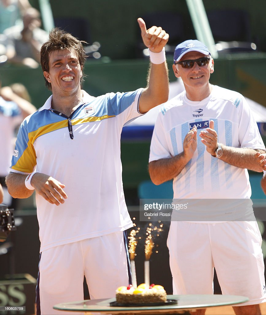 <a gi-track='captionPersonalityLinkClicked' href=/galleries/search?phrase=Carlos+Berlocq&family=editorial&specificpeople=553854 ng-click='$event.stopPropagation()'>Carlos Berlocq</a> of Argentina celebrates his birthday after the fourth match between Argentina and Alemania in the first round of Copa Davis at the Parque Roca Stadium on February 03, 2013 in Buenos Aires, Argentina.