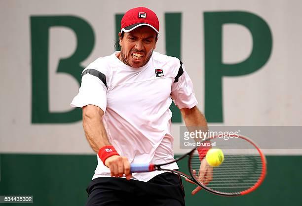 Carlos Berlocq of Argentina hits a backhand during the Men's Singles second round match against David Goffin of Belgium on day five of the 2016...