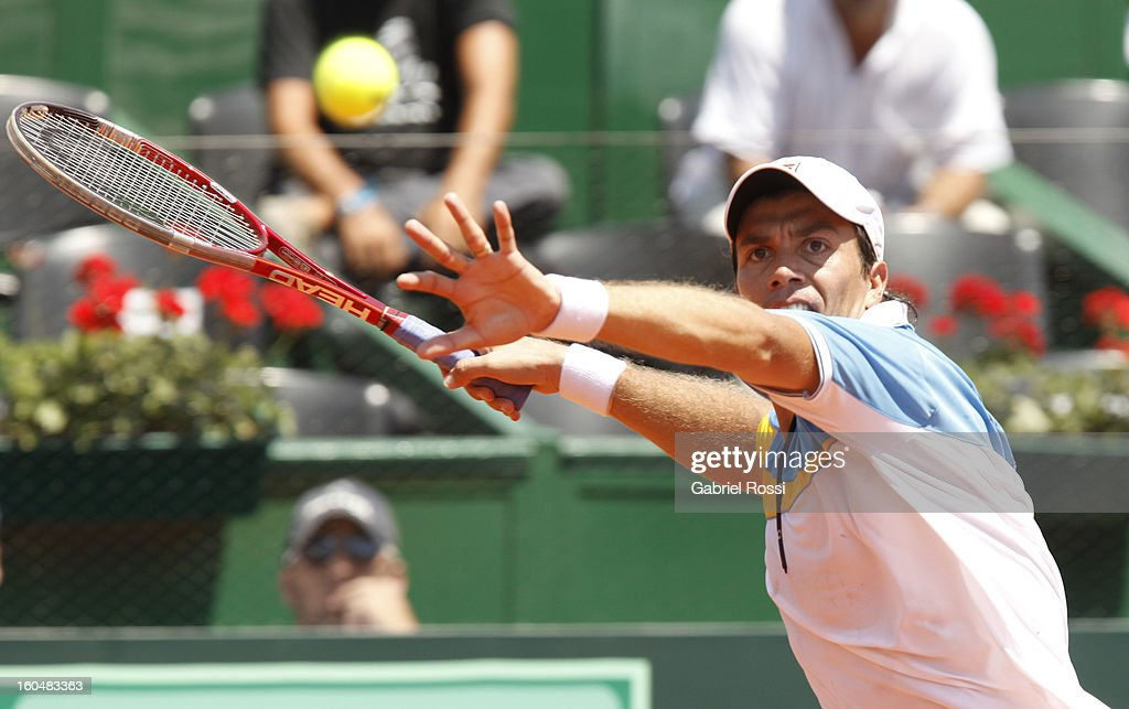 <a gi-track='captionPersonalityLinkClicked' href=/galleries/search?phrase=Carlos+Berlocq&family=editorial&specificpeople=553854 ng-click='$event.stopPropagation()'>Carlos Berlocq</a> of Argentina in action during the first match of the series between Argentina and Germany in the first round of Davis Cup at Parque Roca Stadium on February 01, 2013, Buenos Aires, Argentina.