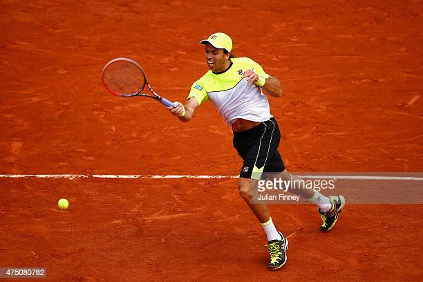 Carlos Berlocq of Argentina plays a forehand in his Men's Singles match against Richard Gasquet of France on day six of the 2015 French Open at...