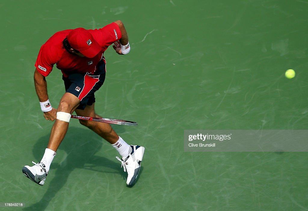 <a gi-track='captionPersonalityLinkClicked' href=/galleries/search?phrase=Carlos+Berlocq&family=editorial&specificpeople=553854 ng-click='$event.stopPropagation()'>Carlos Berlocq</a> of Argentina returns a shot through his legs during his men's singles second round match against Roger Federer of Switzerland on Day Four of the 2013 US Open at USTA Billie Jean King National Tennis Center on August 29, 2013 in the Flushing neighborhood of the Queens borough of New York City.