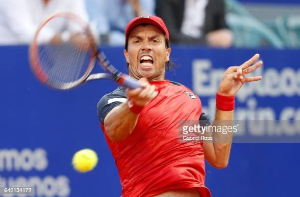 Carlos Berlocq of Argentina takes a forehand shot during a second round match between David Ferrer of Spain and Carlos Berlocq of Argentina as part...