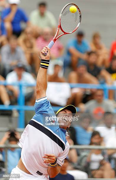 Carlos Berloq of Argentina makes a shot during a match between Argentina and Italy as part of day 3 of the Davis Cup at Patinodromo Stadium on...