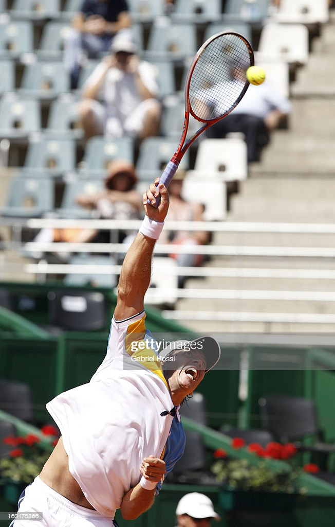 Carlos Berloq of Argentina serves to Philipp Kohlschreiber (not in frame) during the first match of the series between Argentina and Germany in the first round of Davis Cup at Parque Roca Stadium on February 01, 2013, Buenos Aires, Argentina.