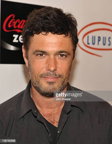Carlos Bernard attends 'Get Lucky For Lupus LA' at Petersen Automotive Museum on September 22 2011 in Los Angeles California
