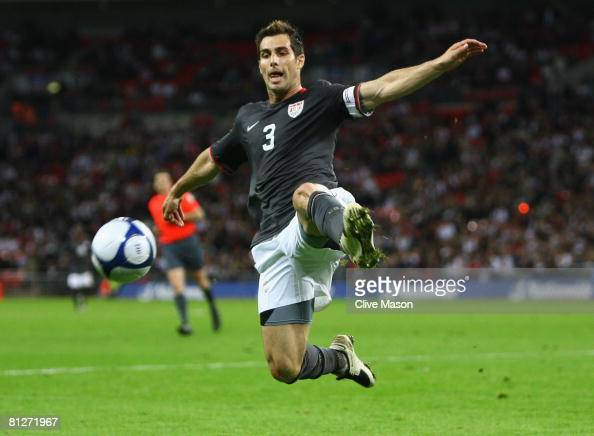 Carlos bocanegra of usa jumps for the ball during the international