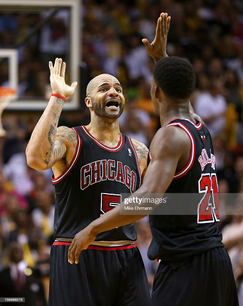 Carlos Boozer #5 and Jimmy Butler #21 of the Chicago Bulls celebrate during a game against the Miami Heat at AmericanAirlines Arena on January 4, 2013 in Miami, Florida.