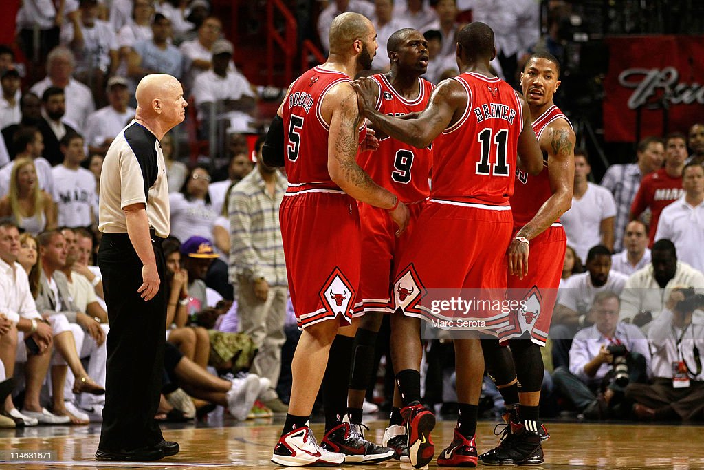 Carlos Boozer #5, Luol Deng #9, Ronnie Brewer #11 and Derrick Rose #1 of the Chicago Bulls huddle up as referee Joey Crawford looks on against the Miami Heat in Game Four of the Eastern Conference Finals during the 2011 NBA Playoffs on May 24, 2011 at American Airlines Arena in Miami, Florida.