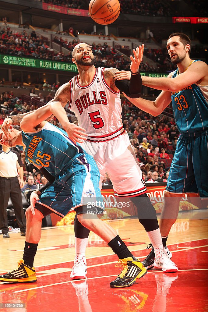 <a gi-track='captionPersonalityLinkClicked' href=/galleries/search?phrase=Carlos+Boozer&family=editorial&specificpeople=201638 ng-click='$event.stopPropagation()'>Carlos Boozer</a> #5 of the Chicago Bulls battles for a loose ball with <a gi-track='captionPersonalityLinkClicked' href=/galleries/search?phrase=Austin+Rivers&family=editorial&specificpeople=7117574 ng-click='$event.stopPropagation()'>Austin Rivers</a> #25 and Ryan Anderson #33 of the New Orleans Hornets during the game on November 3, 2012 at the United Center in Chicago, Illinois.