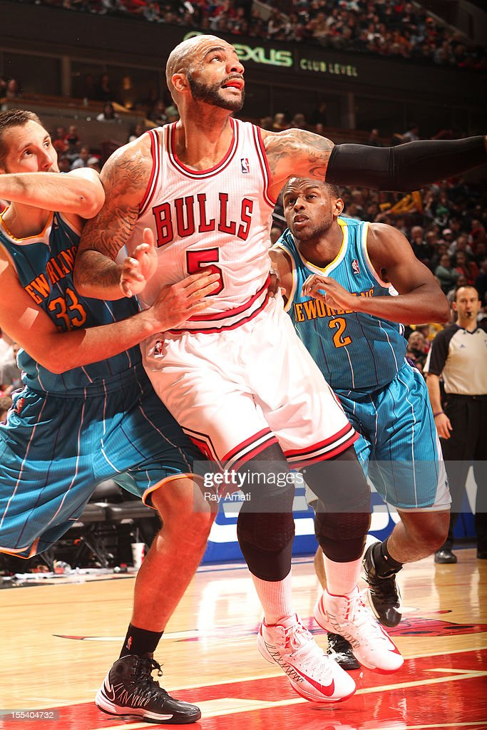 <a gi-track='captionPersonalityLinkClicked' href=/galleries/search?phrase=Carlos+Boozer&family=editorial&specificpeople=201638 ng-click='$event.stopPropagation()'>Carlos Boozer</a> #5 of the Chicago Bulls battles for position against Ryan Anderson #33 and <a gi-track='captionPersonalityLinkClicked' href=/galleries/search?phrase=Darius+Miller&family=editorial&specificpeople=5590631 ng-click='$event.stopPropagation()'>Darius Miller</a> #2 of the New Orleans Hornets on November 3, 2012 at the United Center in Chicago, Illinois.