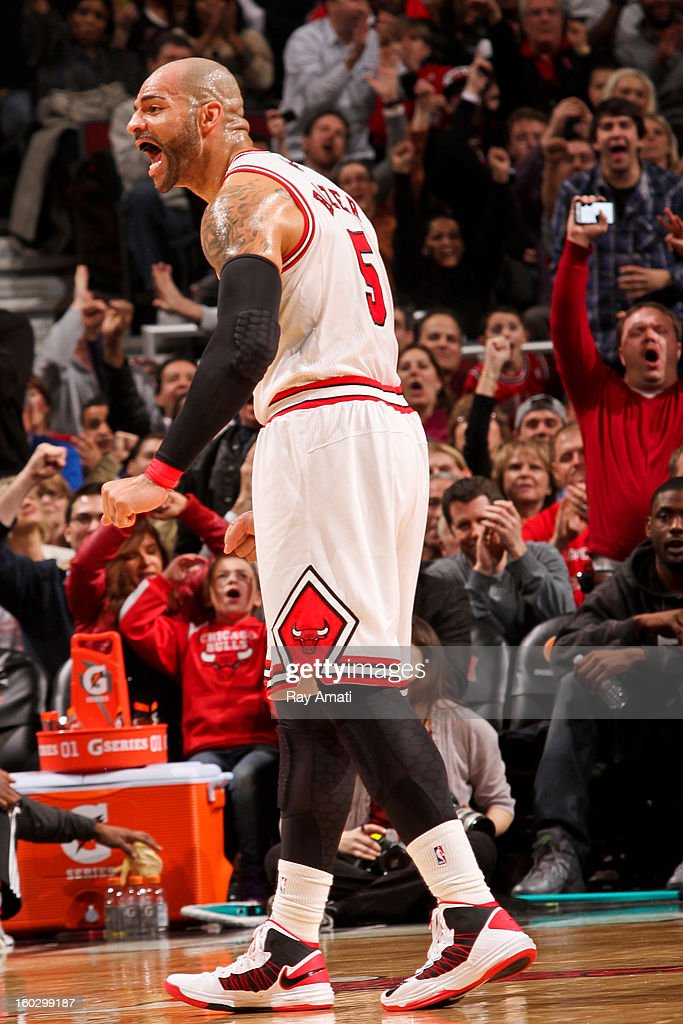Carlos Boozer #5 of the Chicago Bulls celebrates after scoring in the second quarter of a game against the Charlotte Bobcats on January 28, 2013 at the United Center in Chicago, Illinois.
