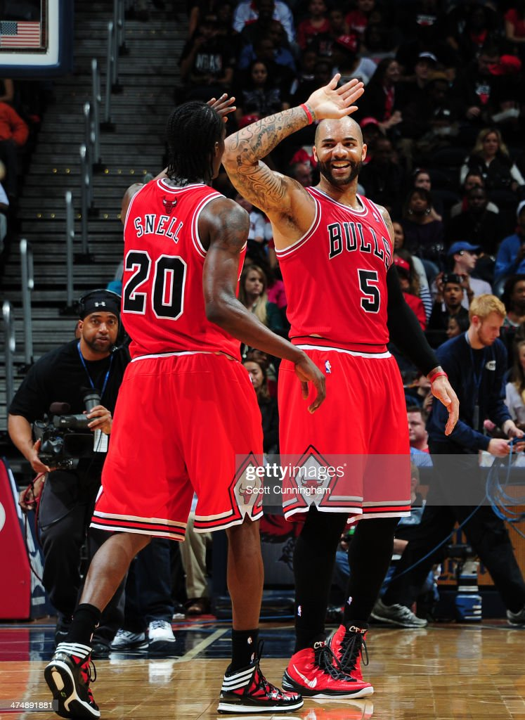 Carlos Boozer #5 of the Chicago Bulls celebrates during the game against the Atlanta Hawks on February 25, 2014 at Philips Arena in Atlanta, Georgia.