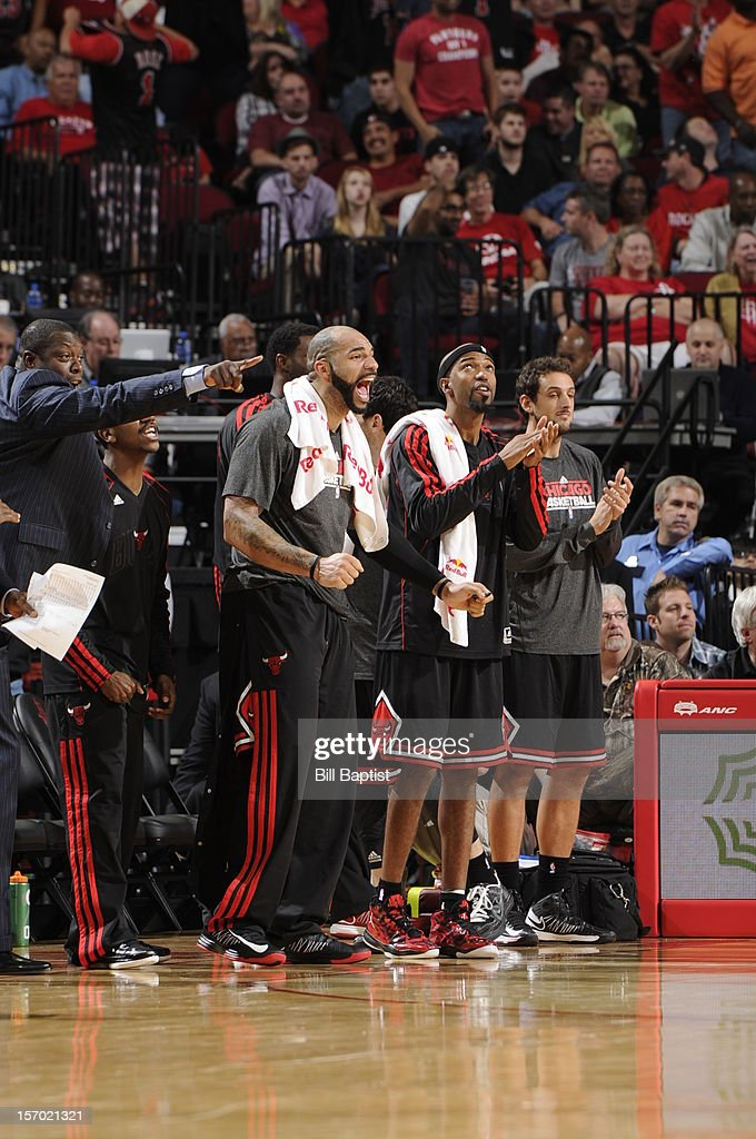 <a gi-track='captionPersonalityLinkClicked' href=/galleries/search?phrase=Carlos+Boozer&family=editorial&specificpeople=201638 ng-click='$event.stopPropagation()'>Carlos Boozer</a> #5 of the Chicago Bulls cheers on his team from the bench in the game against the Houston Rockets on November 21, 2012 at the Toyota Center in Houston, Texas.