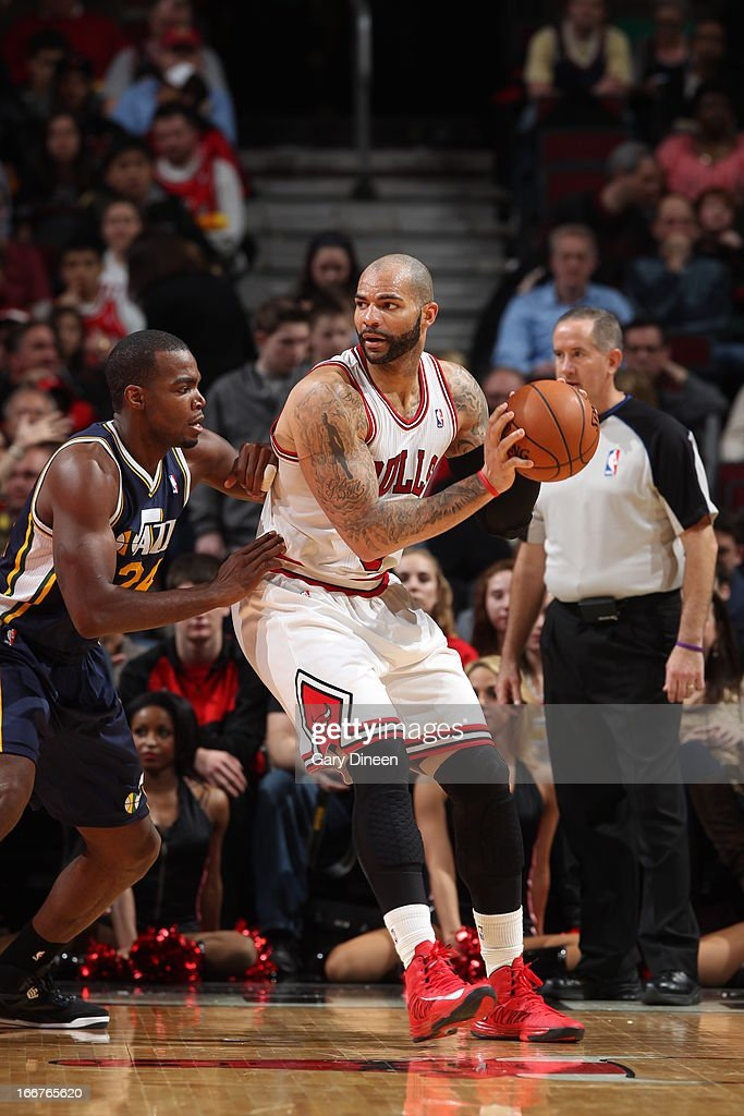 <a gi-track='captionPersonalityLinkClicked' href=/galleries/search?phrase=Carlos+Boozer&family=editorial&specificpeople=201638 ng-click='$event.stopPropagation()'>Carlos Boozer</a> #5 of the Chicago Bulls controls the ball against <a gi-track='captionPersonalityLinkClicked' href=/galleries/search?phrase=Paul+Millsap&family=editorial&specificpeople=880017 ng-click='$event.stopPropagation()'>Paul Millsap</a> #24 of the Utah Jazz on March 08, 2013 at the United Center in Chicago, Illinois.
