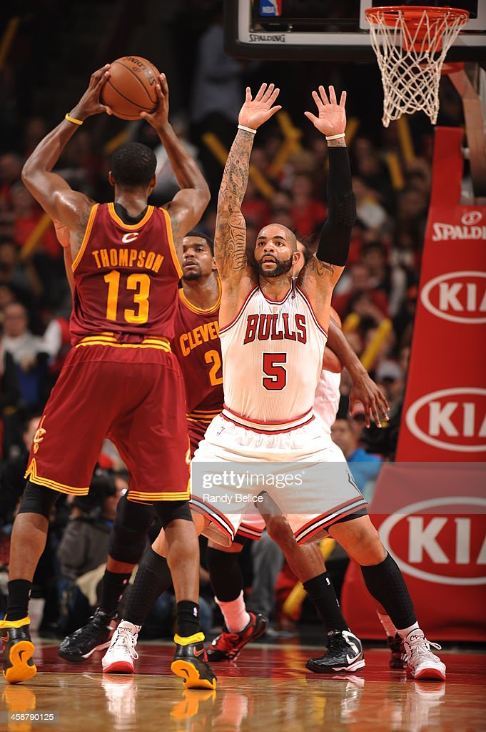 <a gi-track='captionPersonalityLinkClicked' href=/galleries/search?phrase=Carlos+Boozer&family=editorial&specificpeople=201638 ng-click='$event.stopPropagation()'>Carlos Boozer</a> #5 of the Chicago Bulls defends against the Cleveland Cavaliers on December 21, 2013 at the United Center in Chicago, Illinois.