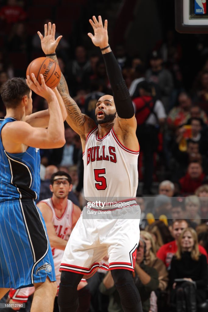 <a gi-track='captionPersonalityLinkClicked' href=/galleries/search?phrase=Carlos+Boozer&family=editorial&specificpeople=201638 ng-click='$event.stopPropagation()'>Carlos Boozer</a> #5 of the Chicago Bulls defends against the Orlando Magic on November 6, 2012 at the United Center in Chicago, Illinois.