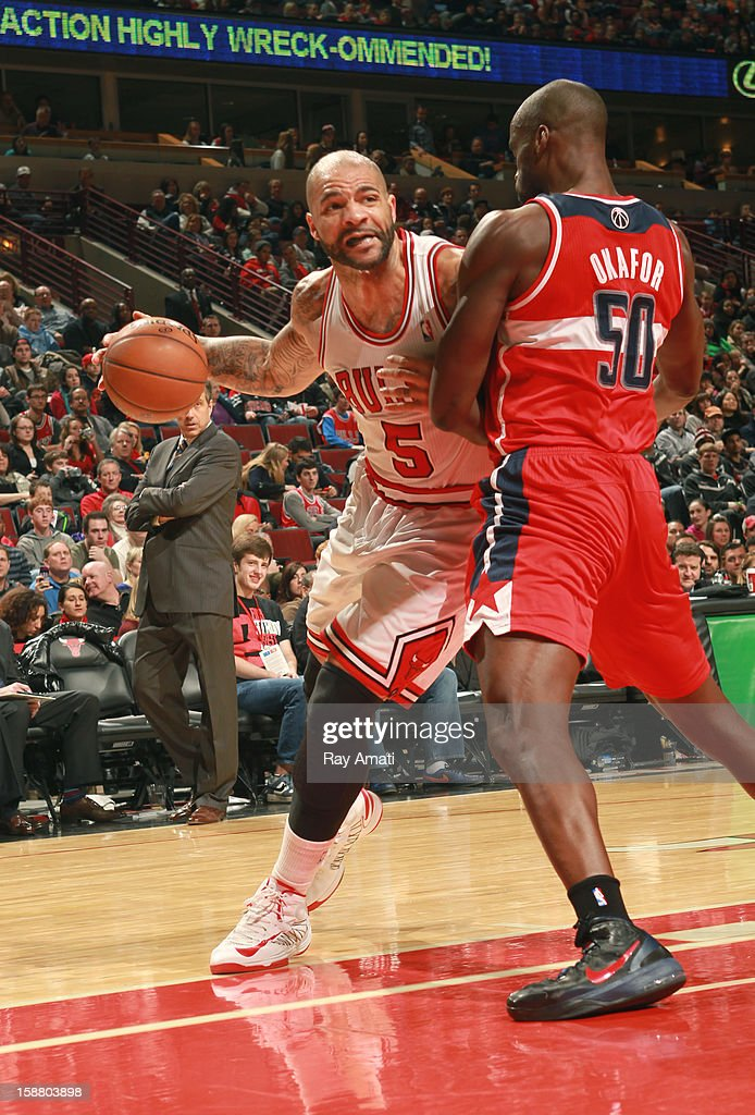 Carlos Boozer #5 of the Chicago Bulls drives against Emeka Okafor #50 of the Washington Wizards on December 29, 2012 at the United Center in Chicago, Illinois.