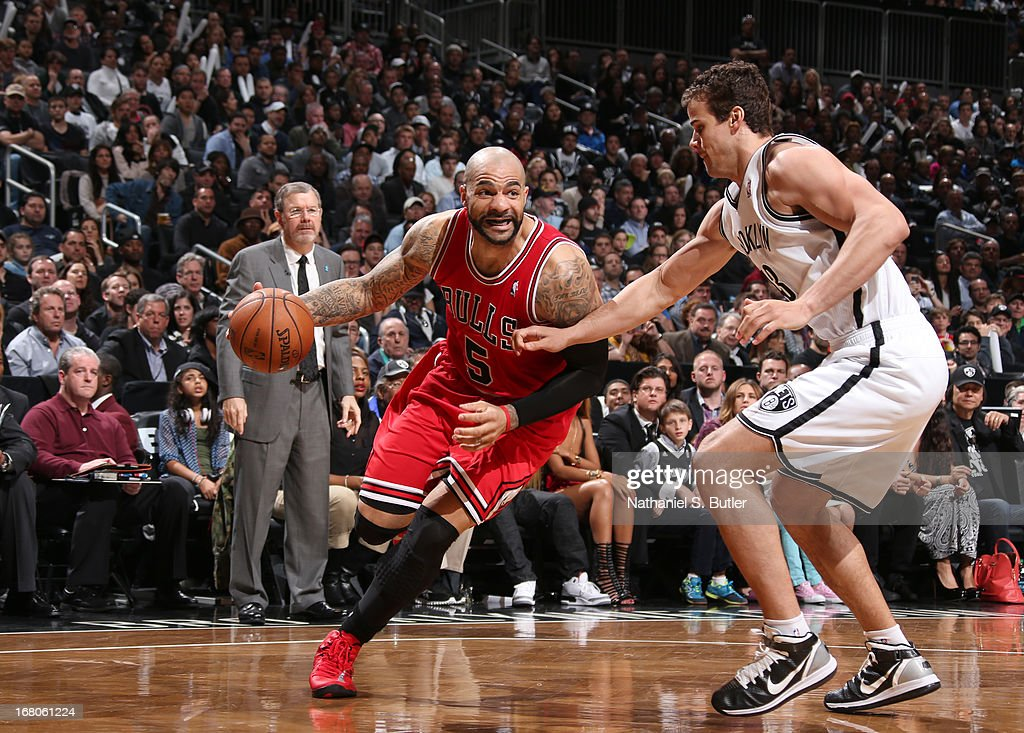 Carlos Boozer #5 of the Chicago Bulls drives against Kris Humphries #43 of the Brooklyn Nets during the Game Seven of the Eastern Conference Quarterfinals between the Chicago Bulls and the Brooklyn Nets during the 2013 NBA Playoffs at the Barclays Center on May 4, 2013 in the Brooklyn borough of New York City.