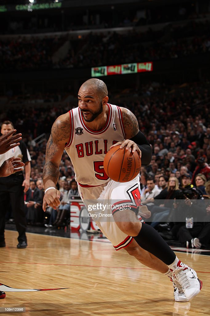 Carlos Boozer #5 of the Chicago Bulls drives against the Miami Heat on February 24, 2011 at the United Center in Chicago, Illinois.