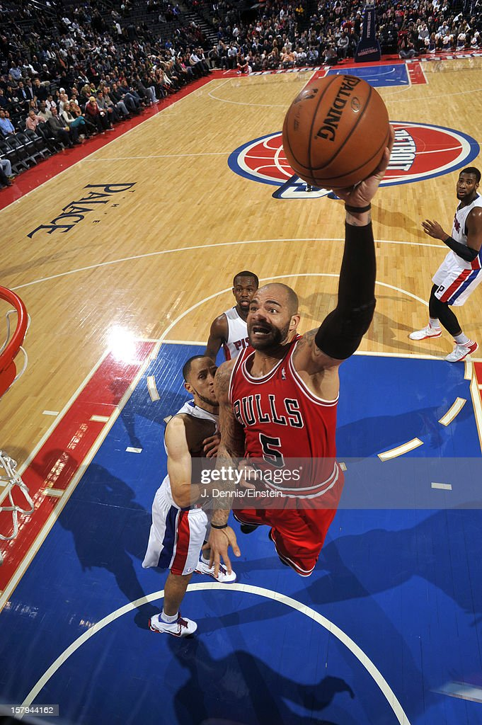 Carlos Boozer #5 of the Chicago Bulls drives to the basket against the Detroit Pistons on December 7, 2012 at The Palace of Auburn Hills in Auburn Hills, Michigan.