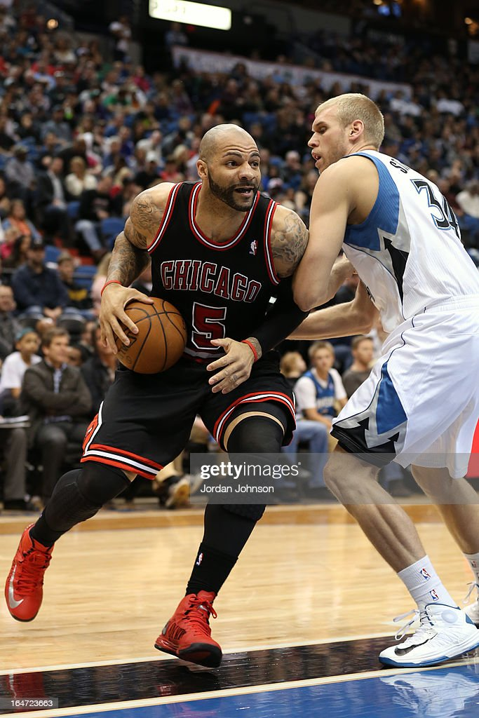 <a gi-track='captionPersonalityLinkClicked' href=/galleries/search?phrase=Carlos+Boozer&family=editorial&specificpeople=201638 ng-click='$event.stopPropagation()'>Carlos Boozer</a> #5 of the Chicago Bulls drives to the basket against the Minnesota Timberwolves on March 24, 2013 at Target Center in Minneapolis, Minnesota.