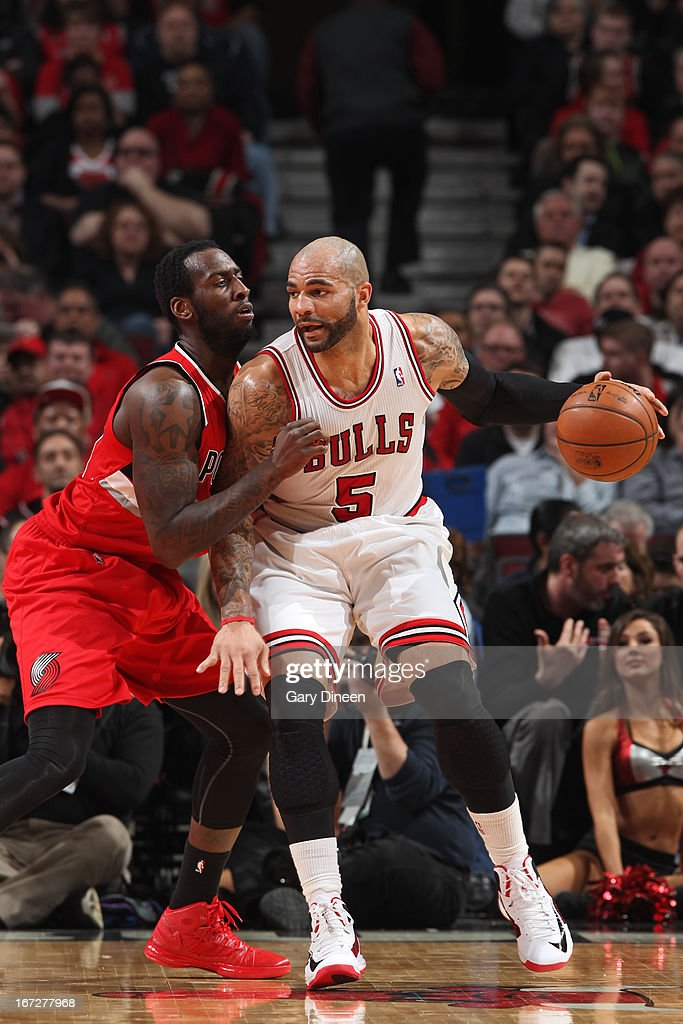 <a gi-track='captionPersonalityLinkClicked' href=/galleries/search?phrase=Carlos+Boozer&family=editorial&specificpeople=201638 ng-click='$event.stopPropagation()'>Carlos Boozer</a> #5 of the Chicago Bulls drives to the basket against the Portland Trail Blazers on March 21, 2013 at the United Center in Chicago, Illinois.