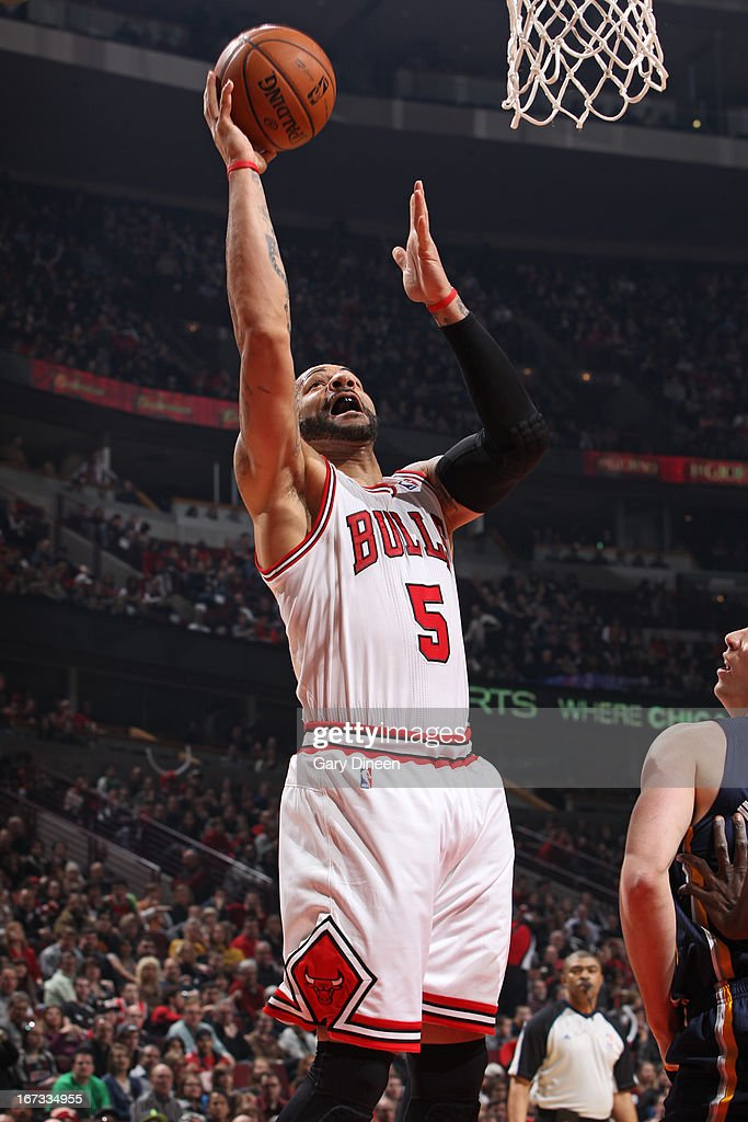 <a gi-track='captionPersonalityLinkClicked' href=/galleries/search?phrase=Carlos+Boozer&family=editorial&specificpeople=201638 ng-click='$event.stopPropagation()'>Carlos Boozer</a> #5 of the Chicago Bulls drives to the basket against the Indiana Pacers on March 23, 2013 at the United Center in Chicago, Illinois.