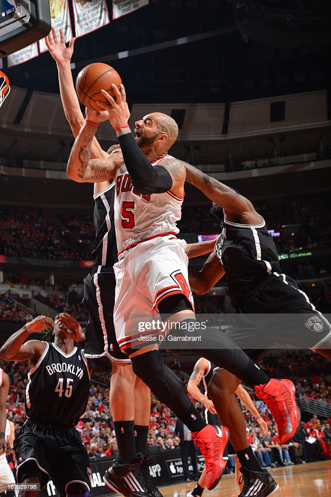 <a gi-track='captionPersonalityLinkClicked' href=/galleries/search?phrase=Carlos+Boozer&family=editorial&specificpeople=201638 ng-click='$event.stopPropagation()'>Carlos Boozer</a> #5 of the Chicago Bulls drives to the basket against the Brooklyn Nets in Game Three of the Eastern Conference Quarterfinals during the 2013 NBA Playoffs on April 25, 2013 at United Center in Chicago, Illinois.
