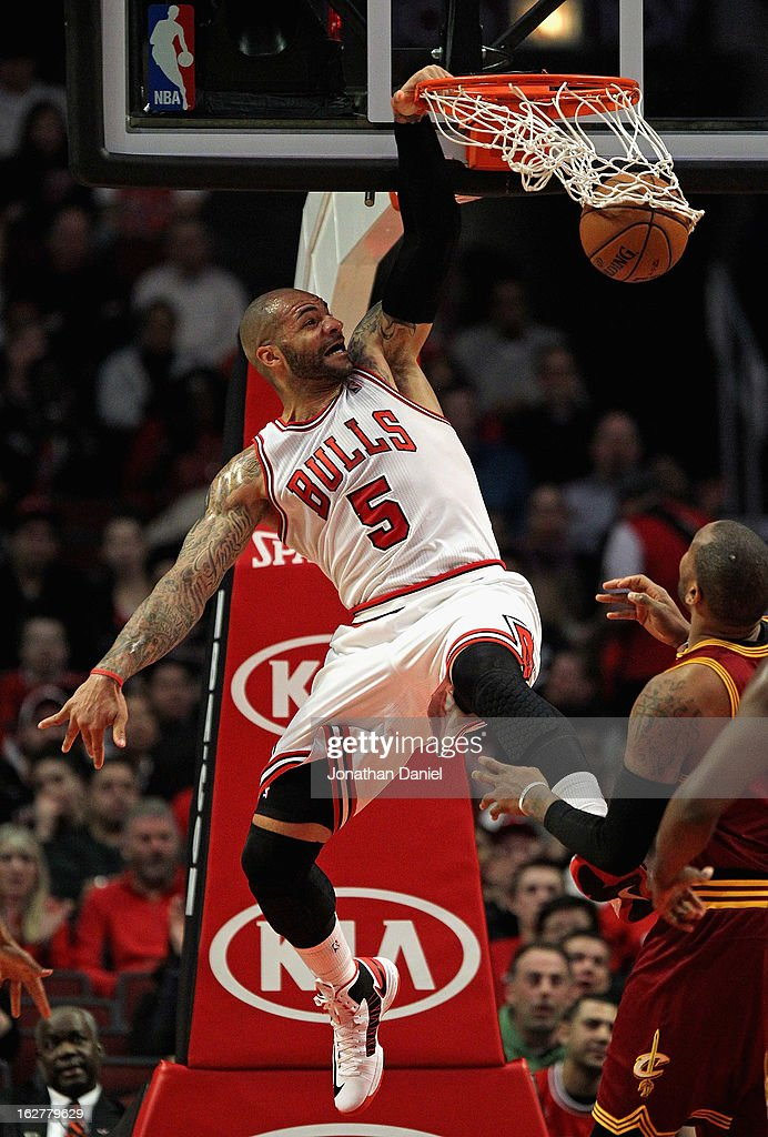 Carlos Boozer #5 of the Chicago Bulls dunbks against the Cleveland Cavaliers at the United Center on February 26, 2013 in Chicago, Illinois.