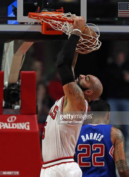 Carlos Boozer of the Chicago Bulls dunks against the Los Angeles Clippers at the United Center on January 24 2014 in Chicago Illinois NOTE TO USER...