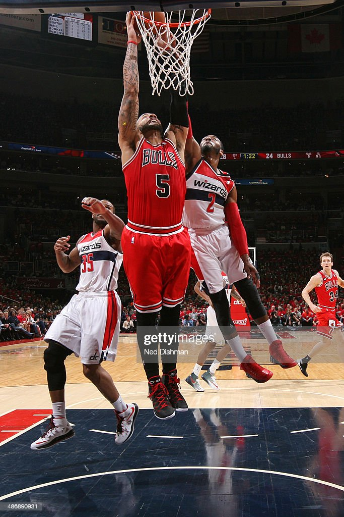 Carlos Boozer #5 of the Chicago Bulls dunks against the Washington Wizards in Game Three of the Eastern Conference Quarterfinals during the 2014 NBA Playoffs at the Verizon Center on April 25, 2014 in Washington, DC.