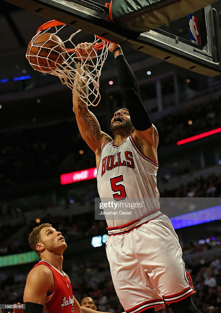 Carlos Boozer #5 of the Chicago Bulls dunks over Blake Griffin #32 of the Los Angeles Clippers on his way to a game-high 24 points at the United Center on December 11, 2012 in Chicago, Illinois. The Clippers defeated the Bulls 94-89.