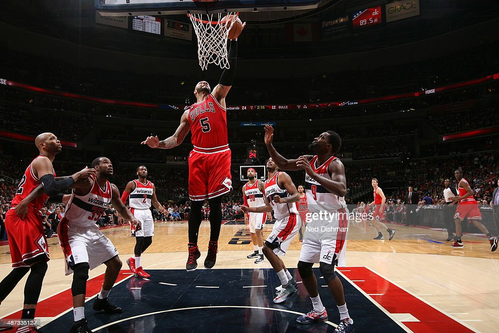 <a gi-track='captionPersonalityLinkClicked' href=/galleries/search?phrase=Carlos+Boozer&family=editorial&specificpeople=201638 ng-click='$event.stopPropagation()'>Carlos Boozer</a> #5 of the Chicago Bulls dunks the ball against the Washington Wizards in Game Four of the Eastern Conference Quarterfinals during the 2014 NBA Playoffs at the Verizon Center on April 27, 2014 in Washington, DC.