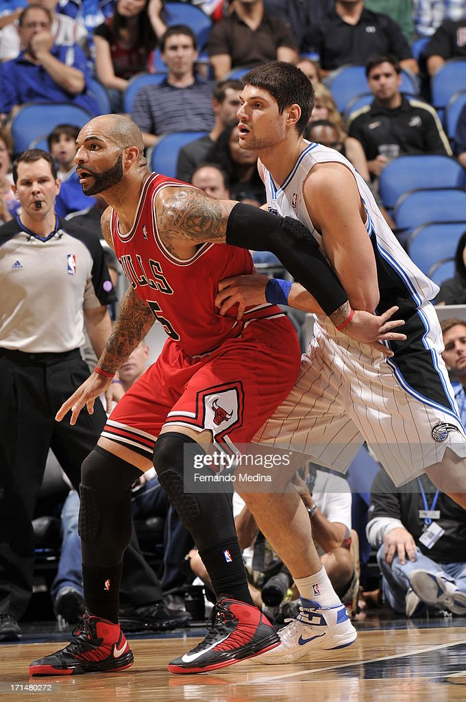 <a gi-track='captionPersonalityLinkClicked' href=/galleries/search?phrase=Carlos+Boozer&family=editorial&specificpeople=201638 ng-click='$event.stopPropagation()'>Carlos Boozer</a> #5 of the Chicago Bulls fights for position against Nikola Vucevic #9 of the Orlando Magic during a game on April 15, 2013 at Amway Center in Orlando, Florida.