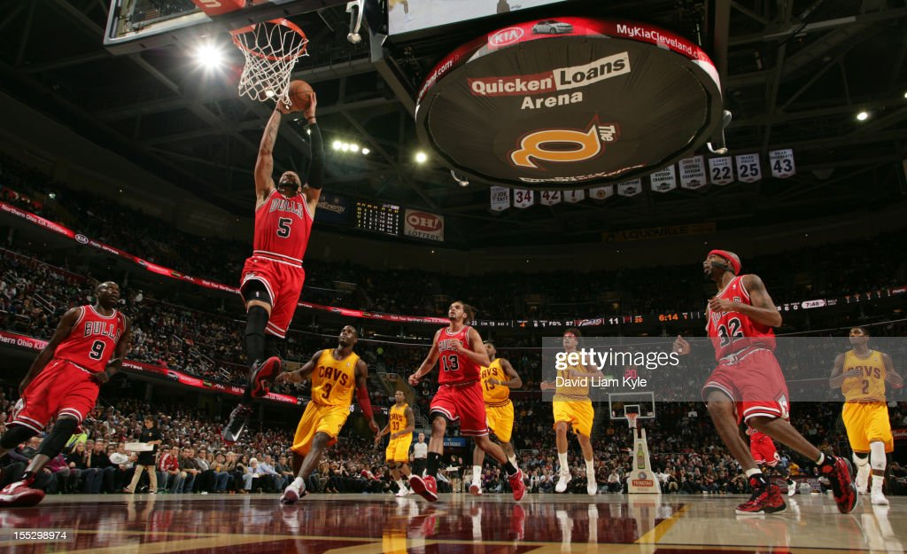 <a gi-track='captionPersonalityLinkClicked' href=/galleries/search?phrase=Carlos+Boozer&family=editorial&specificpeople=201638 ng-click='$event.stopPropagation()'>Carlos Boozer</a> #5 of the Chicago Bulls flies in for the dunk trailed by <a gi-track='captionPersonalityLinkClicked' href=/galleries/search?phrase=Dion+Waiters&family=editorial&specificpeople=6902921 ng-click='$event.stopPropagation()'>Dion Waiters</a> #3 of the Cleveland Cavaliers at The Quicken Loans Arena on November 2, 2012 in Cleveland, Ohio.