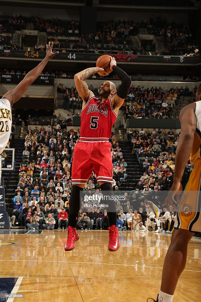 Carlos Boozer #5 of the Chicago Bulls goes for a jump shot during the game between the Indiana Pacers and the Chicago Bulls on February 4, 2013 at Bankers Life Fieldhouse in Indianapolis, Indiana.