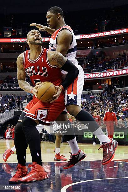 Carlos Boozer of the Chicago Bulls goes to the basket against Kevin Seraphin of the Washington Wizards during the first half at Verizon Center on...