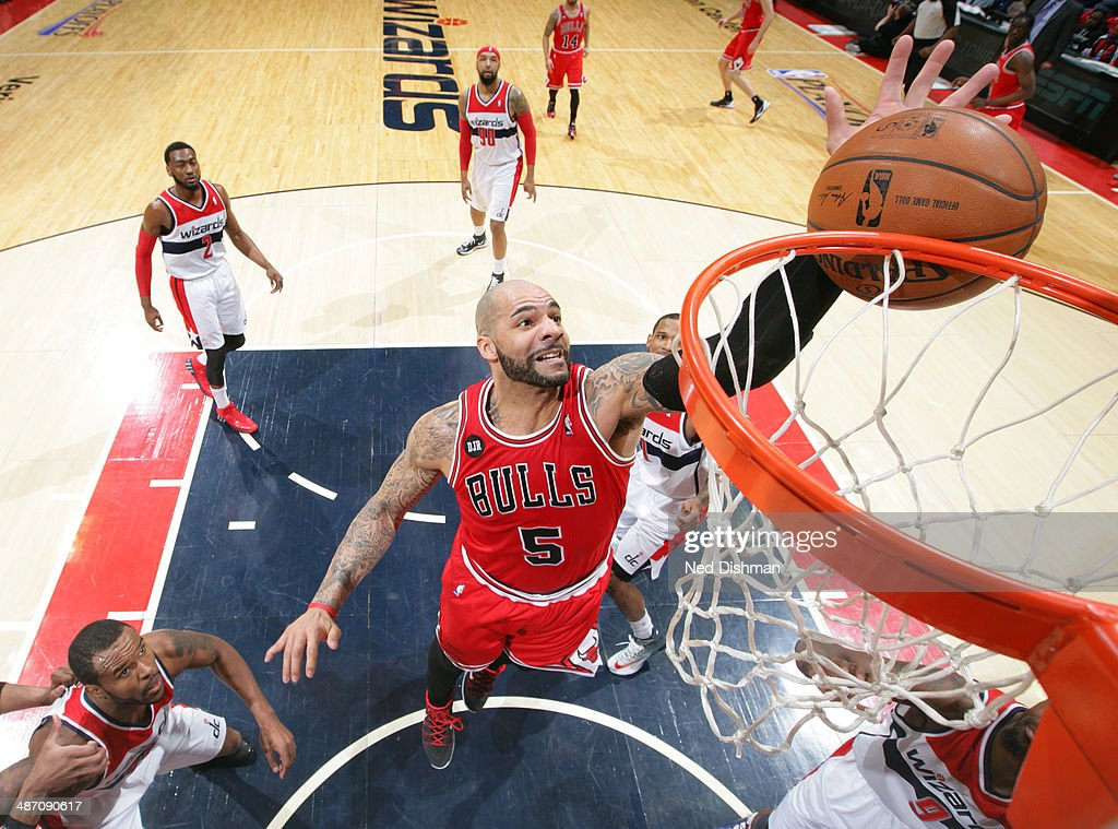 Carlos Boozer #5 of the Chicago Bulls grabs a rebound against the Washington Wizards in Game Four of the Eastern Conference Quarterfinals during the 2014 NBA Playoffs at the Verizon Center on April 27, 2014 in Washington, DC.