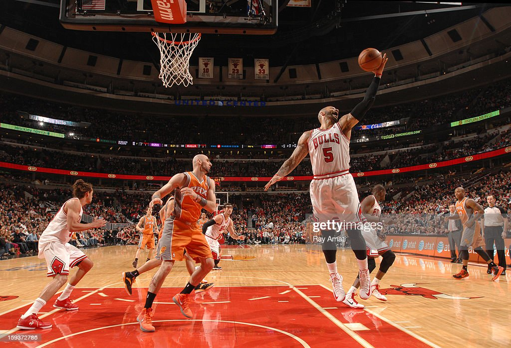 Carlos Boozer #5 of the Chicago Bulls grabs a rebound during the game against the Phoenix Suns on January 12, 2013 at the United Center in Chicago, Illinois.