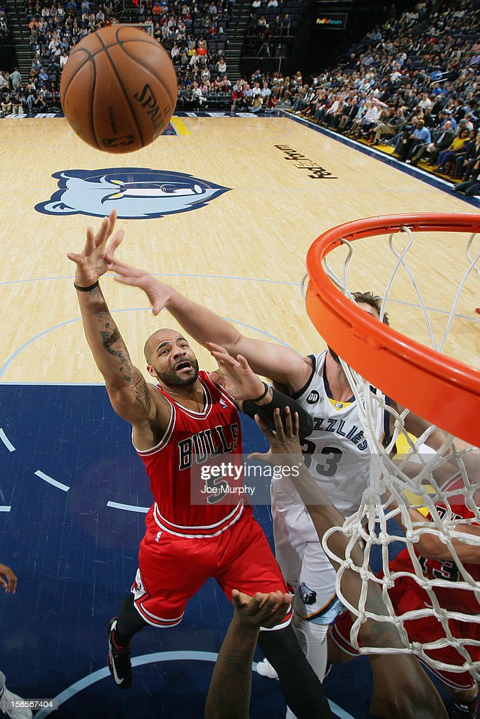 <a gi-track='captionPersonalityLinkClicked' href=/galleries/search?phrase=Carlos+Boozer&family=editorial&specificpeople=201638 ng-click='$event.stopPropagation()'>Carlos Boozer</a> #5 of the Chicago Bulls grabs a rebound over <a gi-track='captionPersonalityLinkClicked' href=/galleries/search?phrase=Marc+Gasol&family=editorial&specificpeople=661205 ng-click='$event.stopPropagation()'>Marc Gasol</a> #33 of the Memphis Grizzlies on December 17, 2012 at FedExForum in Memphis, Tennessee.