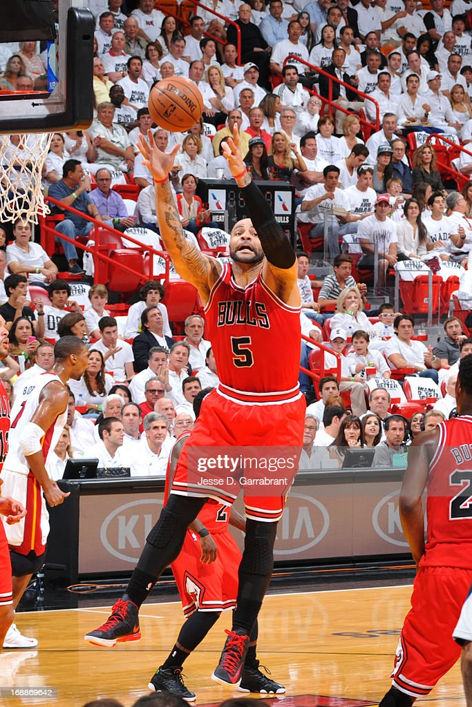 Carlos Boozer #5 of the Chicago Bulls grabs the ball against the Miami Heat in Game Five of the Eastern Conference Semifinals during the 2013 NBA Playoffs on May 15, 2013 at American Airlines Arena in Miami, Florida.