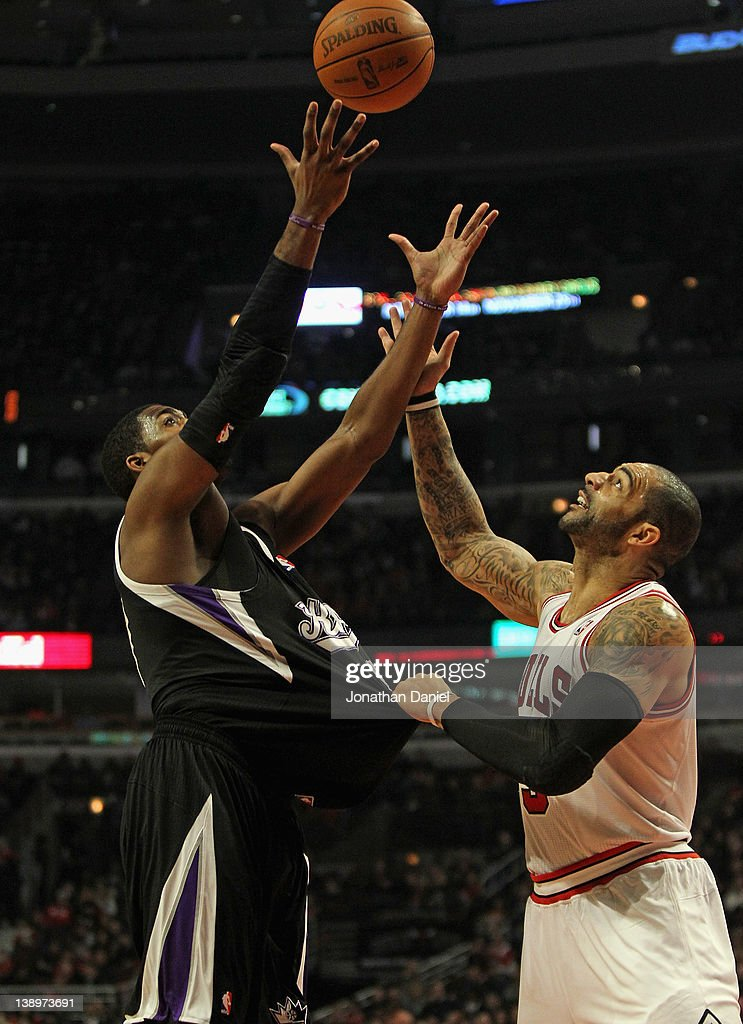 <a gi-track='captionPersonalityLinkClicked' href=/galleries/search?phrase=Carlos+Boozer&family=editorial&specificpeople=201638 ng-click='$event.stopPropagation()'>Carlos Boozer</a> #5 of the Chicago Bulls grabs the jersey of Jason Thompson #34 of the Sacramento Kings as he tries to rebound at the United Center on February 14, 2012 in Chicago, Illinois.