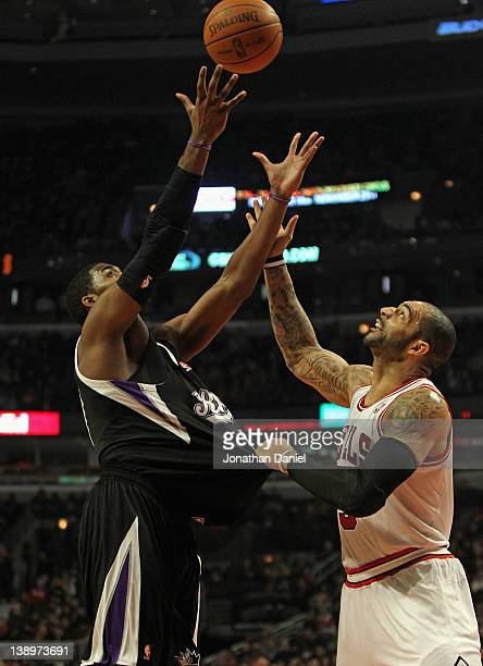 Carlos Boozer of the Chicago Bulls grabs the jersey of Jason Thompson of the Sacramento Kings as he tries to rebound at the United Center on February...