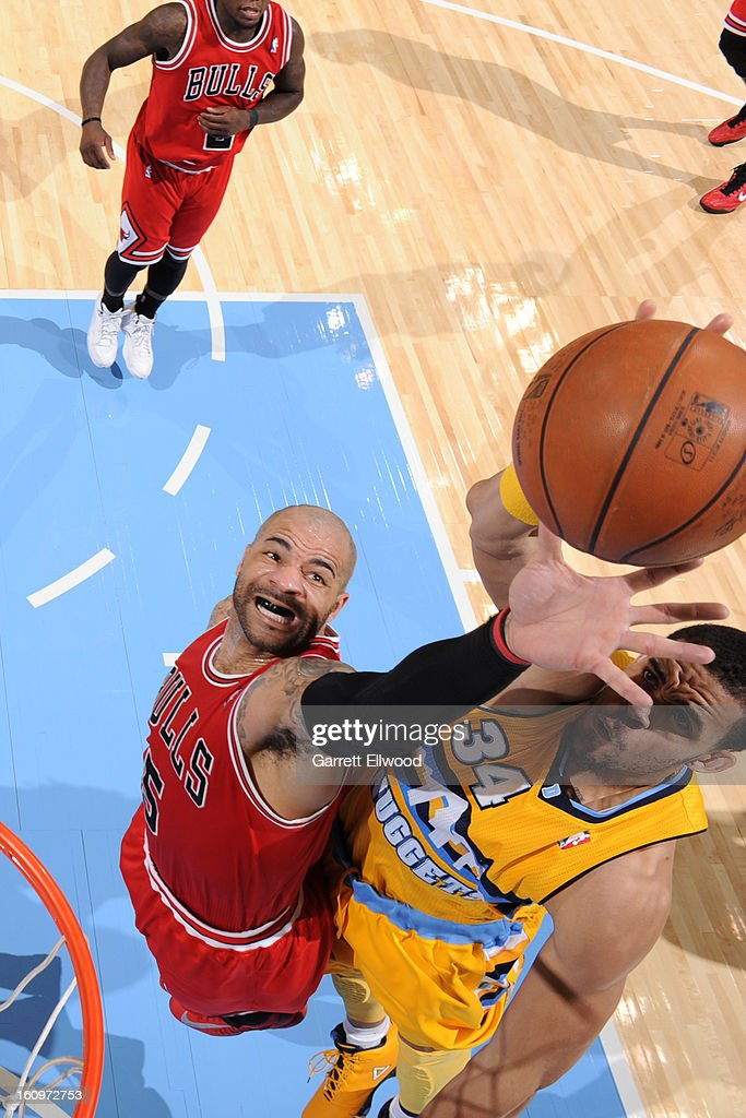 <a gi-track='captionPersonalityLinkClicked' href=/galleries/search?phrase=Carlos+Boozer&family=editorial&specificpeople=201638 ng-click='$event.stopPropagation()'>Carlos Boozer</a> #5 of the Chicago Bulls grabs the rebound against <a gi-track='captionPersonalityLinkClicked' href=/galleries/search?phrase=JaVale+McGee&family=editorial&specificpeople=4195625 ng-click='$event.stopPropagation()'>JaVale McGee</a> #34 of the Denver Nuggets on February 7, 2013 at the Pepsi Center in Denver, Colorado.