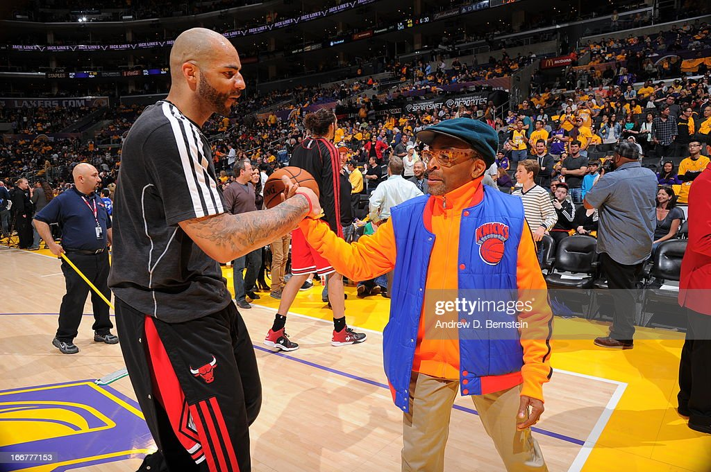 <a gi-track='captionPersonalityLinkClicked' href=/galleries/search?phrase=Carlos+Boozer&family=editorial&specificpeople=201638 ng-click='$event.stopPropagation()'>Carlos Boozer</a> #5 of the Chicago Bulls greets Film director, <a gi-track='captionPersonalityLinkClicked' href=/galleries/search?phrase=Spike+Lee&family=editorial&specificpeople=156419 ng-click='$event.stopPropagation()'>Spike Lee</a>, before the game against the Los Angeles Lakers at Staples Center on March 10, 2013 in Los Angeles, California.