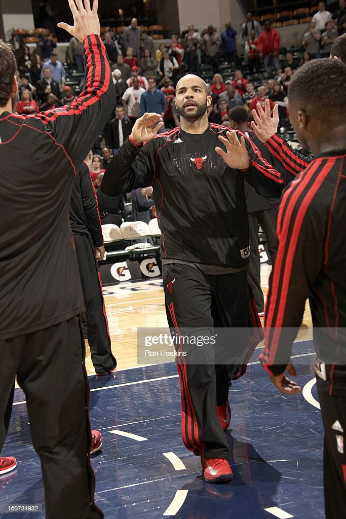 <a gi-track='captionPersonalityLinkClicked' href=/galleries/search?phrase=Carlos+Boozer&family=editorial&specificpeople=201638 ng-click='$event.stopPropagation()'>Carlos Boozer</a> #5 of the Chicago Bulls greets teammates during the game between the Indiana Pacers and the Chicago Bulls on February 4, 2013 at Bankers Life Fieldhouse in Indianapolis, Indiana.
