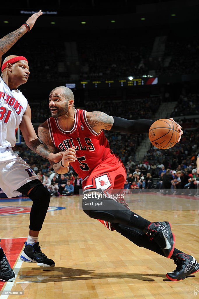 Carlos Boozer #5 of the Chicago Bulls handles the ball against Charlie Villanueva #31 of the Detroit Pistons on December 7, 2012 at The Palace of Auburn Hills in Auburn Hills, Michigan.